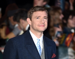 "English actor Martin Freeman poses for pictures on the red carpet upon arrival for the world premier of ""The Hobbit: The Battle of the Five Armies"" in central London on December 1, 2014. AFP PHOTO/LEON NEAL"